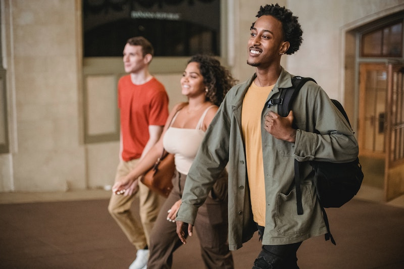 multiethnic students walking to class